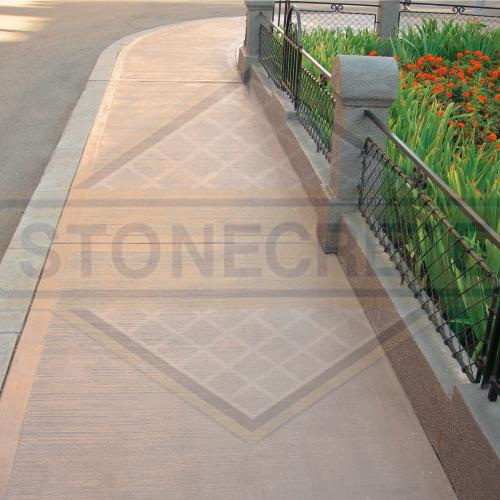 STONECRETE COMBED FLOORING, FOR NON-SKIDDING QUALITIES WITHOUT HARSH TEXTURE. IT IS CONSTRUCTED ON FRESH CONCRETE WITH STONECRETE COLOUR HARDENERS AND GIVEN TEXTURE WITH METALLIC TOOLS